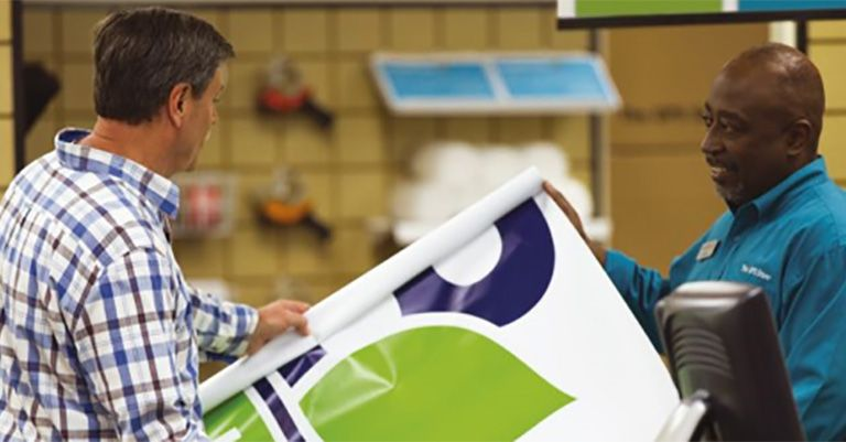 2 men looking at a banner print